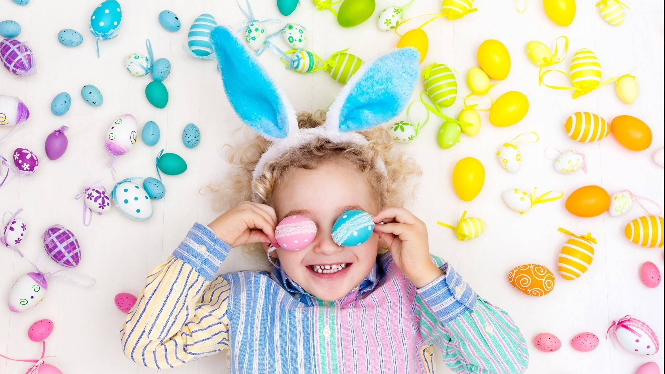 Child wearing sunglasses and bunny ears