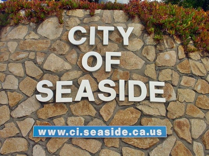 City of Seaside sign on rock wall
