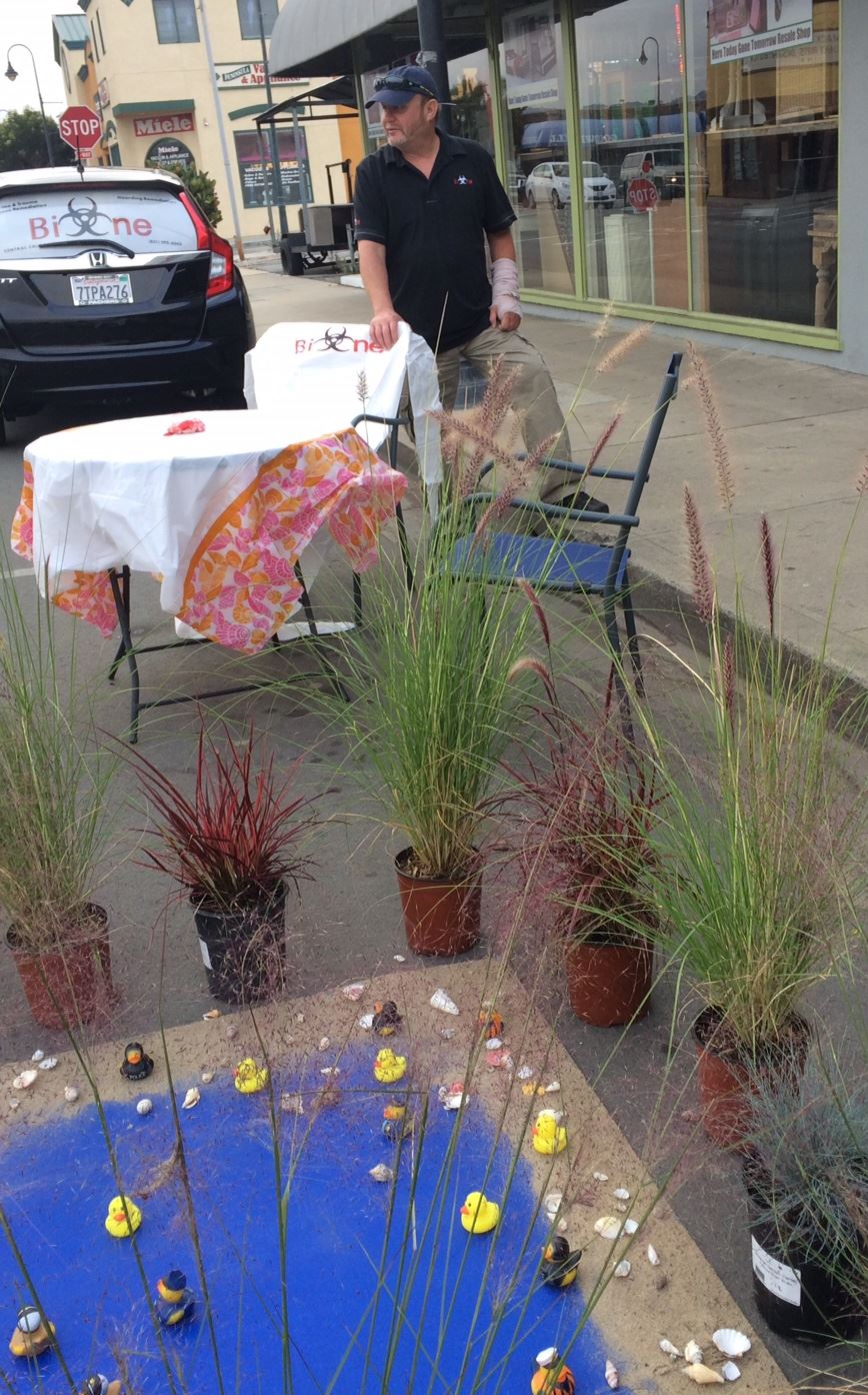 Table and chairs outside during Park(ing) day