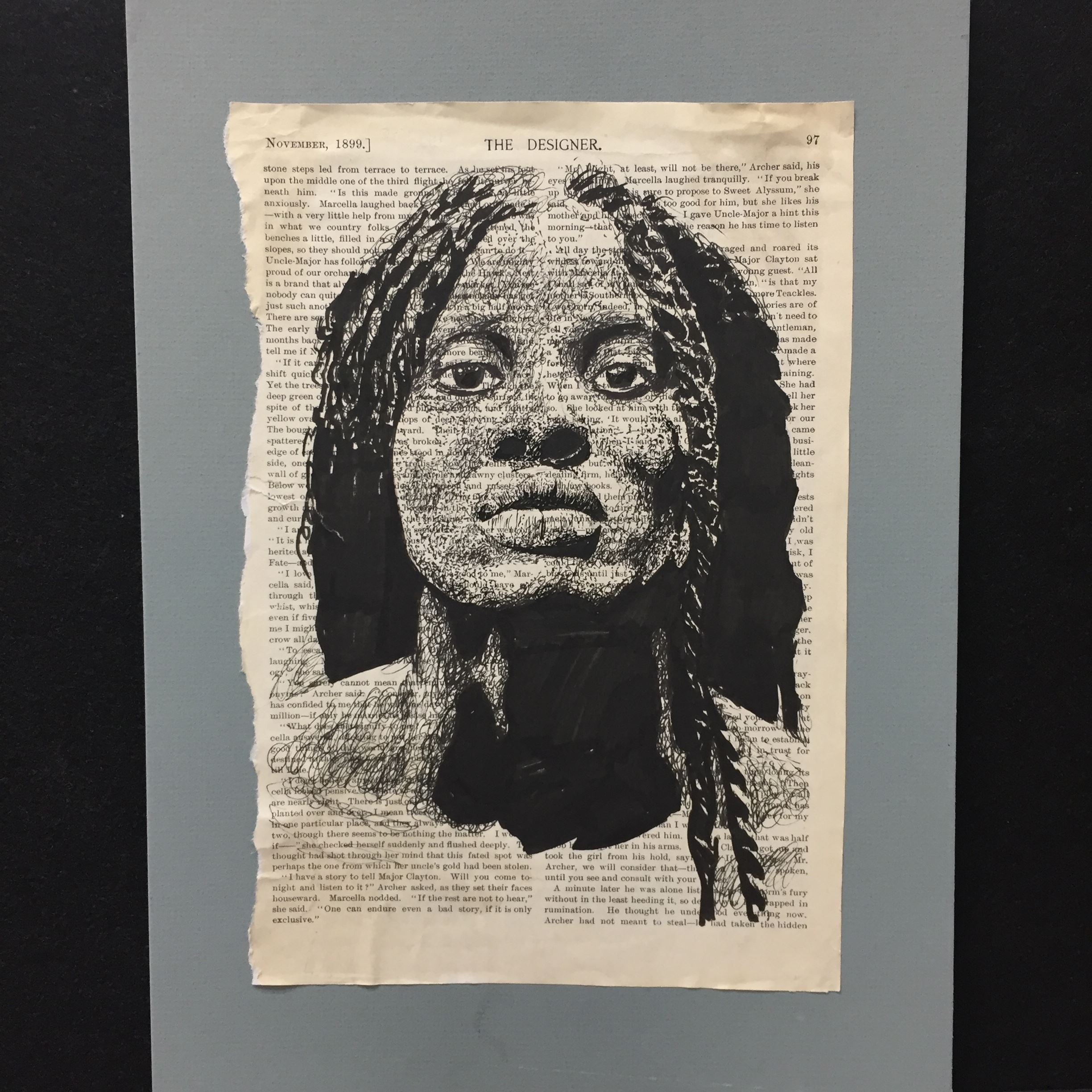 Black and white sketch of woman's face on printed text