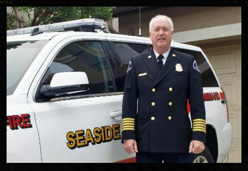 Fire Chief Brian Dempsey near fire command vehicle