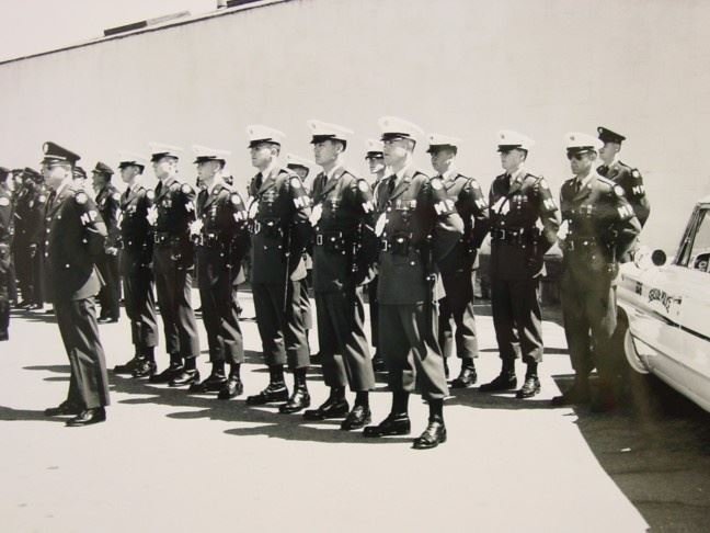 Historical photo of Police Officers Patrolling With Army MPs