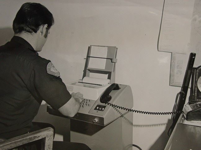 Historical photo of Seaside officer on dial-up CLETS terminal in 1965