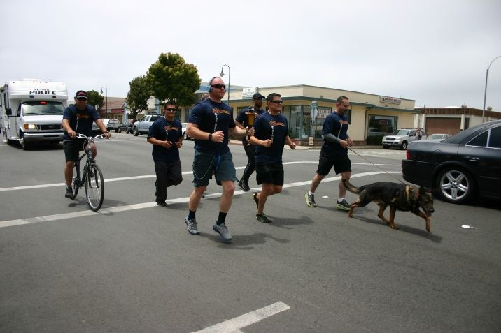 Officers Running With a Dog and Officer On a Bike