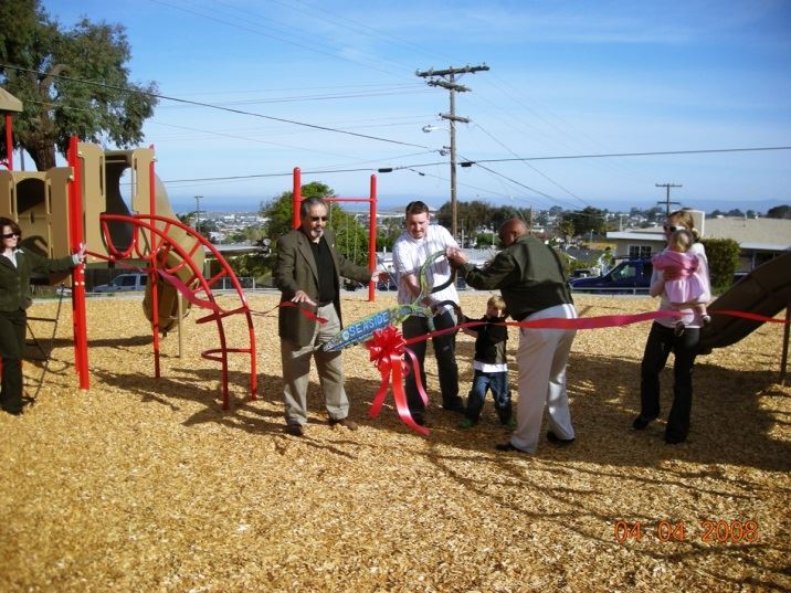 Red ribbon cut by Mayor Rubio and others at new park site
