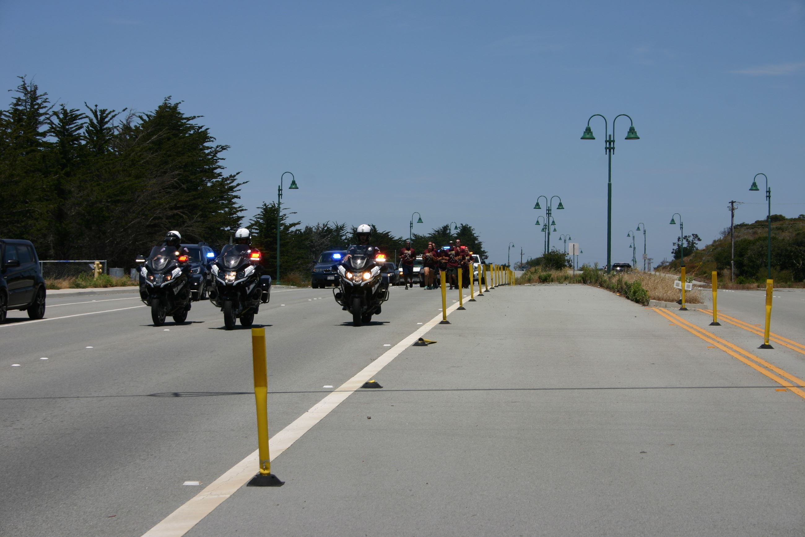 CSUMB PD motorcycles escorting Torch Run participants along road